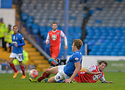 Macclesfield Towns Danny Whitehead and Portsmouths Adam Webster slide in for a tackle during the The FA Cup match between Portsmouth and Macclesfield Town at Fratton Park, Portsmouth, England on 7 November 2015. Photo by Adam Rivers.