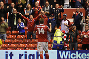 Nottingham Forest forward Nicklas Bendtner (14) celebrities in front of the Forest fans after scoring a goal to put the Reds 1-0 during the EFL Sky Bet Championship match between Nottingham Forest and Fulham at the City Ground, Nottingham, England on 27 September 2016. Photo by Jon Hobley.