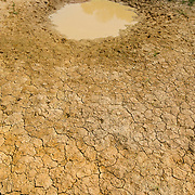 Dried up lake bed as a a result of an extended hot season in Thailand.