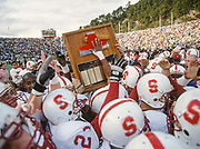 COLLEGE FOOTBALL: The Stanford Cardinal football team with The Axe following their win of the Big Game vs Cal on November 21, 1992 at Memorial Stadium in Berkeley, California.  Photograph by David Madison(WWW.DAVIDMADISON.COM).