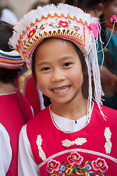 "United States, Washington, Seattle. Chinese New Year celebration in Seattle's ""International District"", traditional home of the city's Asian community. Young girl in traditional costume."