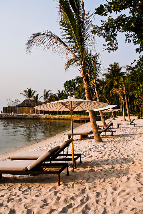 Beach and umbrellas at sunset. Song Saa Private Island