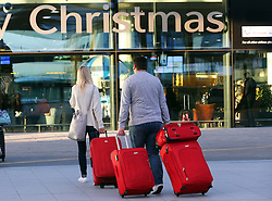 Families  arriving at check in at London Gatwick airport as the Christmas getaway starts Friday, 20th December 2013. Picture by Stephen Lock / i-Images