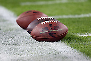 Three balls are lined up on the field for pregame warmups before the Jacksonville Jaguars NFL week 14 football game against the Houston Texans on Thursday, Dec. 5, 2013 in Jacksonville, Fla. The Jaguars won the game 27-20. ©Paul Anthony Spinelli