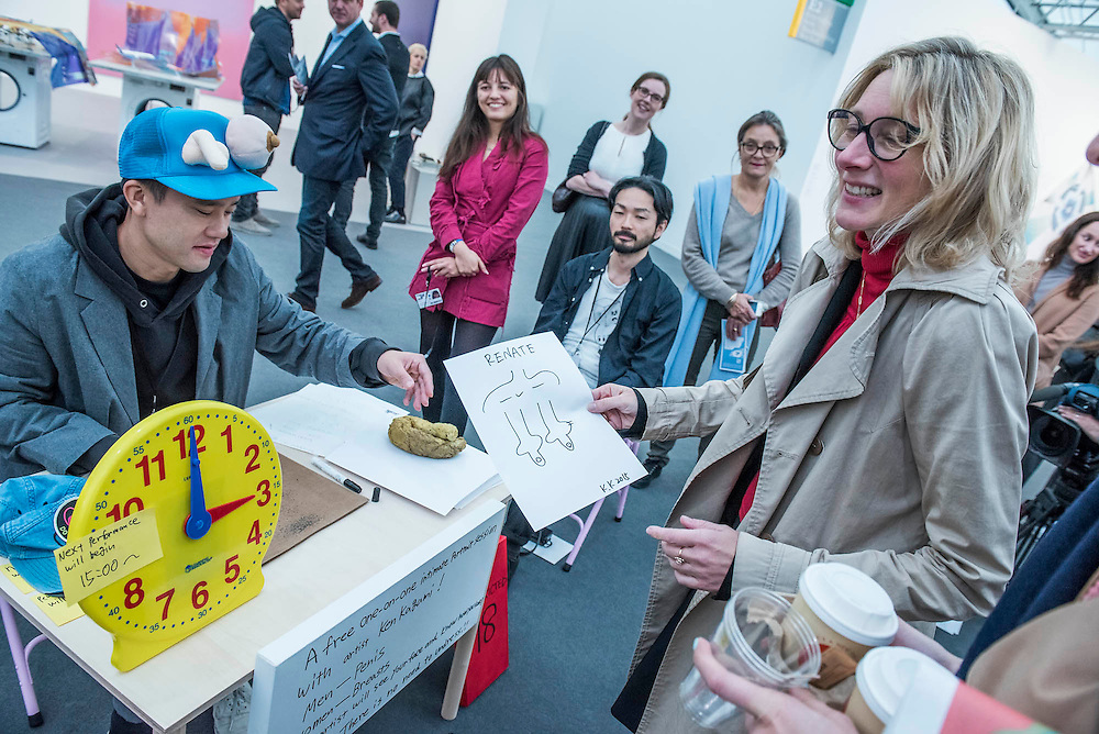 Ken Kagami draws sketches of mens genitals and womens bresasts for a large queue of visitors - Frieze London 2015, Regents Park, London. Frieze London is one of the few fairs to focus only on contemporary art and living artists. The exhibiting galleries represent the most 'exciting' contemporary galleries working today. The focus on living artists is also evident in the critically acclaimed Frieze Projects' programme. The fair presents a curated programme of talks, artists' commissions and film projects, many of which are interactive or performative and encourage visitors to engage with art and artists directly. The fair is open to the public 14–17 October.