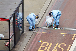 **PREVIOUSLY UNSEEN PICTURES** <br /> &copy; Licensed to London News Pictures. 04/06/2017. LONDON, UK.  General view of forensic officers investigating the scene at London Bridge where Khuram Butt, Rachid Redouane and Youssef Zaghba murdered at least eight people in a terror attack. Photo credit: Cliff Hide/LNP