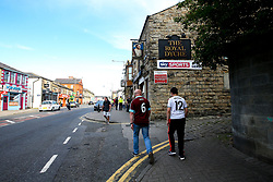 Fans walk past The Royal Dyche Pub, next to Turf Moor, named after Burnley manager Sean Dyche - Mandatory by-line: Robbie Stephenson/JMP - 30/08/2018 - FOOTBALL - Turf Moor - Burnley, England - Burnley v Olympiakos - UEFA Europa League Play-offs second leg