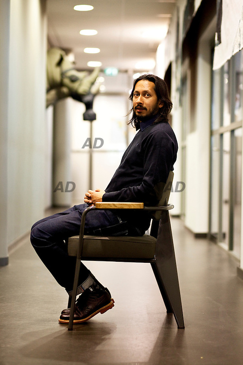 Shubhankar Ray, G-Star global brand director, sit on a chair Jean Prouvè.