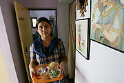 Sangeeta Patkar's maid brings condiments to the table fore breakfast. (Supporting image from the project Hungry Planet: What the World Eats.) The Patkar family of Ujjain, Madhya Pradesh, India, is one of the thirty families featured, with a weeks' worth of food, in the book Hungry Planet: What the World Eats.