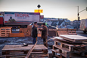 """Two passersby are discussing at the barrikades blockading a building supplies store named """"Epicenter"""" in the city of Lviv, Ukraine."""