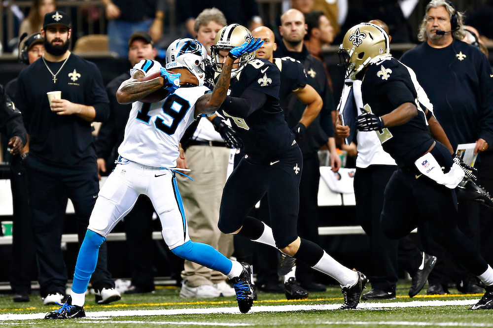 NEW ORLEANS, LA - DECEMBER 8:  Thomas Morstead #6 of the New Orleans Saints tackles Ted Ginn Jr. #19 of the Carolina Panthers by the face mask at Mercedes-Benz Superdome on December 8, 2013 in New Orleans, Louisiana.  (Photo by Wesley Hitt/Getty Images) *** Local Caption *** Thomas Morstead; Ted Ginn Jr.