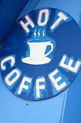 "Hand-painted sign advertising ""Hot Coffee"" at Wild Blueberry Land, a roadside attraction in Downeast Maine."