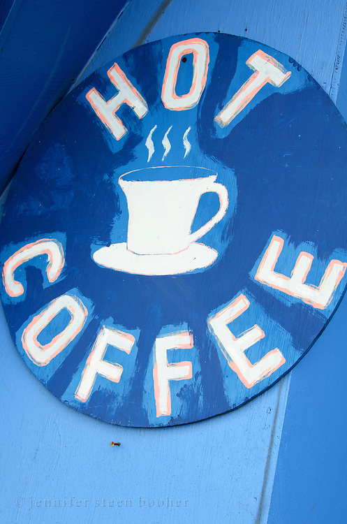 """Hand-painted sign advertising """"Hot Coffee"""" at Wild Blueberry Land, a roadside attraction in Downeast Maine."""