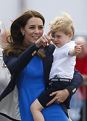 ©  London News Pictures. 08/07/2016. RAF Fairford, UK. CATHERINE, Duchess of Cambridge and Prince GEORGE  during a visit to the International Air Tattoo at RAF Fairford in Gloucestershire where Prince George was introduced to the Red Arrows.  Photo credit: Ian Schofield/LNP
