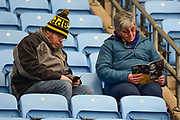 Two Wasps fans read their programmes during the Aviva Premiership match between Wasps and Exeter Chiefs at the Ricoh Arena, Coventry, England on 18 February 2018. Picture by Dennis Goodwin.