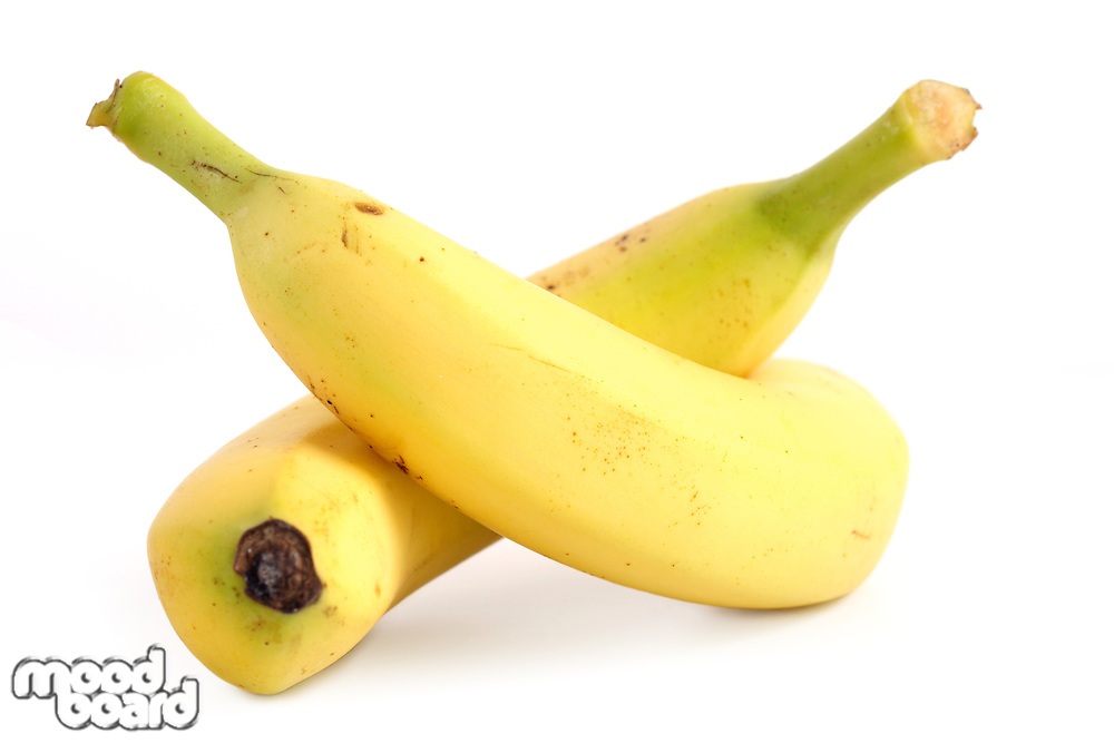 Close-up of two bananas on white background