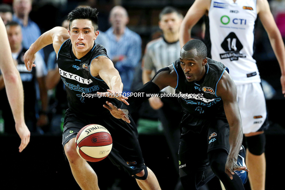 Reuben Te Rangi and Cedric Jackson of the Breakers go after a loose ball. 2014/15 ANBL, SkyCity Breakers vs Melbourne United, Vector Arena, Auckland, New Zealand. Friday 21 November 2014. Photo: Anthony Au-Yeung / photosport.co.nz