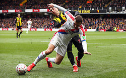 Watford's Gerard Deulofeu (left) and Crystal Palace's James McArthur battle for the ball during the FA Cup quarter final match at Vicarage Road, Watford.