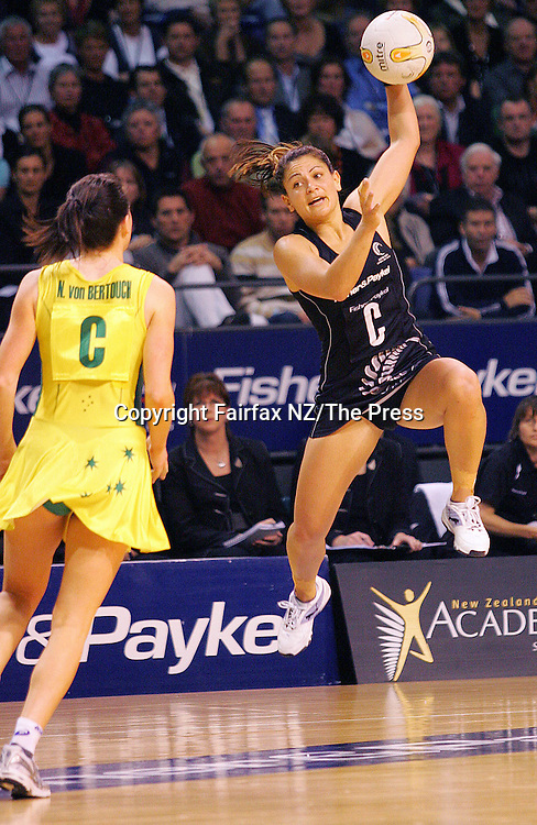 Silver Ferns centre Temepara George leaps high over her Australian opposite Natalie van Bertouch during the third and deciding netball test match between New Zealand and Australia held at the Westpac  Trust Stadium in Christchurch.Australia won the match 46-40 to clinch the Fisher and Paykel Series.