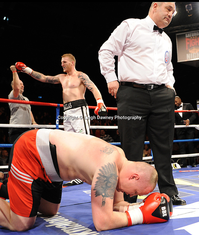 Tom Dallas (white shorts) defeats Werner Kreiskott at Brentwood Centre, Brentwood, Essex on the 5th February 2011. Frank Maloney Promotions. Photo credit © Leigh Dawney