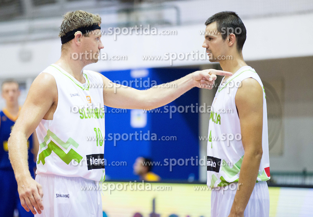 Miha Zupan of Slovenia and Jure Balazic of Slovenia during friendly basketball match between National teams of Slovenia and Ukraine at day 3 of Adecco Cup 2014, on July 26, 2014 in Rogaska Slatina, Slovenia. Photo by Vid Ponikvar / Sportida.com