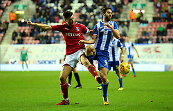 Will Grigg of Wigan Athletic takes on Johnnie Jackson of Charlton Athletic - Mandatory by-line: Robbie Stephenson/JMP - 29/12/2017 - FOOTBALL - DW Stadium - Wigan, England - Wigan Athletic v Charlton Athletic - Sky Bet League One