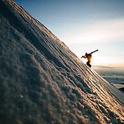 Forrest Jillson hikes for sunrise powder in Wyoming.