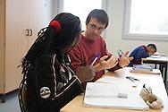 France. Champigny sur Marne, Seine Saint Denis . Elsa Triolet school,  mathematics classroom with two teachers mme Lerouyer   and the referent teacher Eric Legof,  Elsa Triolet school, Education prioritaire program. in the Suburb of Paris.   / Classe de mathematiques avec 2 professeurs, Ecole Elsa Triolet en banlieue. programme education prioritaire,