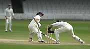 Photo Peter Spurrier.01/09/2002.Village Cricket Final - Lords.Elvaston C.C. vs Shipton-Under-Wychwood C.C..Elvaston Skipper Richard johnson look's back to see the bails lifting as he is stumped by Shipton keeper Shane Duff.
