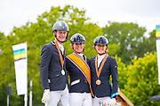 Podium Nederlands Kampioenschap ZZ Zwaar 1. Gerdine Maree - Holiday, 2. Diederik van Silfhout - Impression, 3. Floor van Kempen - Echt Mooi<br /> NK Dressuur 2019<br /> © DigiShots