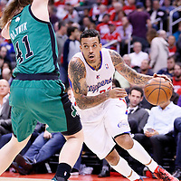 08 January 2014: Los Angeles Clippers small forward Matt Barnes (22) drives past Boston Celtics center Kelly Olynyk (41) during the Los Angeles Clippers 111-105 victory over the Boston Celtics at the Staples Center, Los Angeles, California, USA.