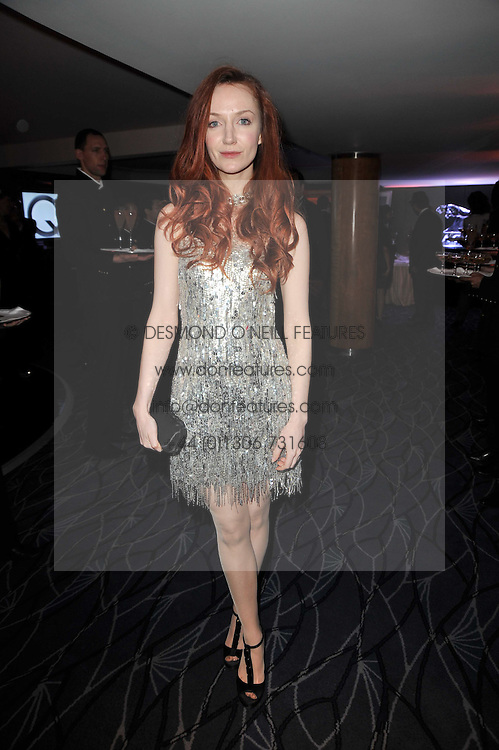 Actress OLIVIA GRANT at Quintessentially's 10th birthday party held at The Savoy Hotel, London on 13th December 2010.