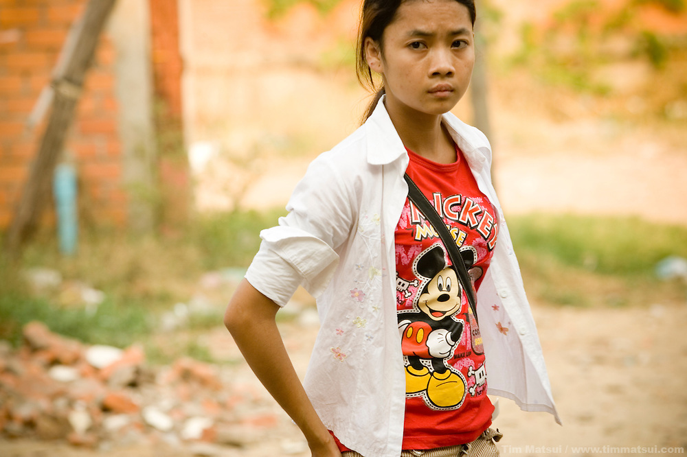 Srey Neth, a 19 year-old Cambodian, stands where the shack she and her mother lived in a slum in Phnom Penh, Cambodia. At 14 her mother sold her to a neighborhood pimp for $300; he then sold her virginity for the same price then forced her to have sex with upwards of 20 men per night. If she refused she was beaten or electrocuted. She was rescued in a buy-bust operation by the NGO International Justice Mission in cooperation with the Cambodian authorities and over the last five years lived at various victim aftercare facilities, most recently Transitions Cambodia where she is now a spokesperson and staff member.