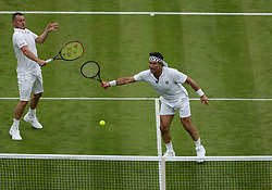 Lleyton Hewitt and Pat Cash on No.1 court at The All England Lawn Tennis Club, London.