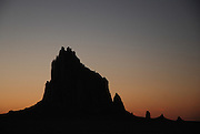 The prominent rock formation known as Shiprock lies in the northwest corner of New Mexico on the Navajo Nation. This landmark plays a central role in Navajo mythology and the traditional beliefs of the Dine´ people.