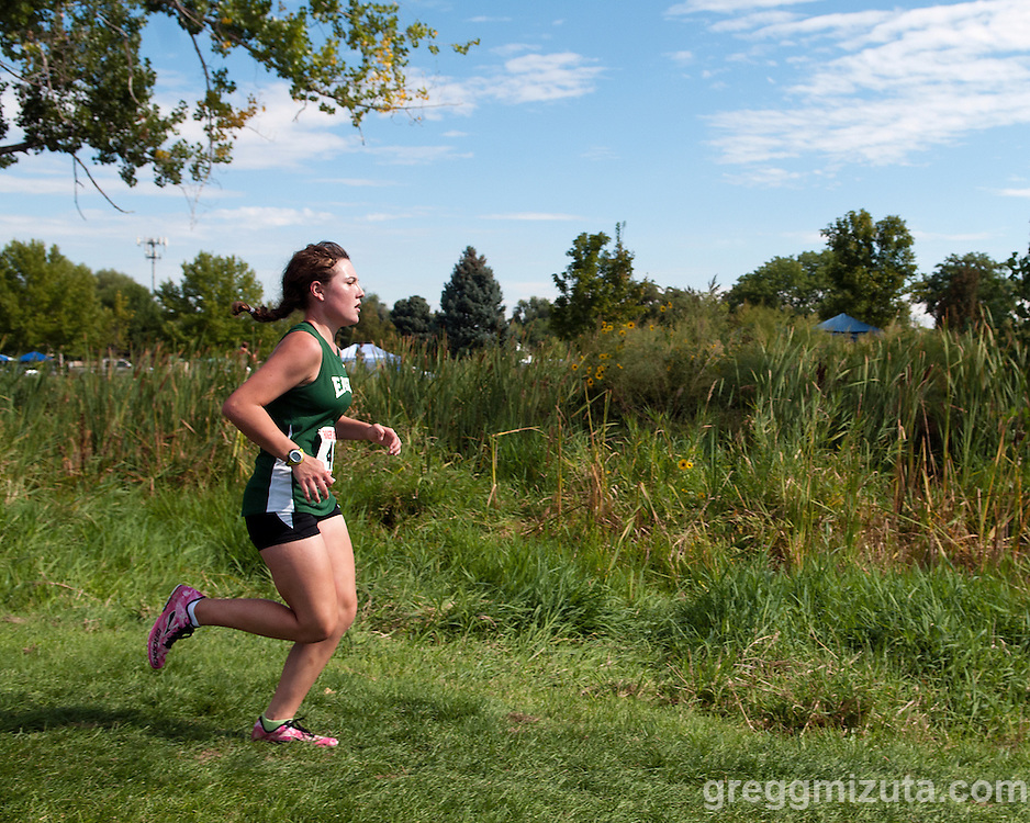 Eagle junior Megan Dupree on the second loop of the Roger Curran Invitational 5k varsity race at West Park in Nampa, Idaho on September 14, 2013. Dupree finished fourth with a time of 20:51.93.