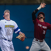 Delaware Infielder Nick Liggett (22) attempts to catch a fly ball near first base during a regular season baseball game between Delaware and Saint Joseph's at Bob Hannah Stadium Tuesday April 19, 2016, in Newark.