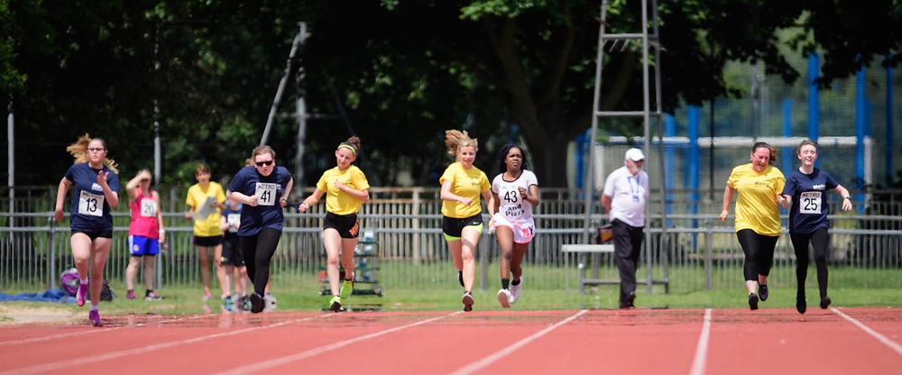 Metro Blind Sport's 2017 Athletics Open held at Mile End Stadium.  100m.  From left, Nell Doubledee, Hannah Bromley-Challenor with guide runner, Precious Ntumy-Kamara with guide runner and Christina Tytler with guide runner<br /> <br /> Picture: Chris Vaughan Photography for Metro Blind Sport<br /> Date: June 17, 2017