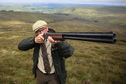 © Licensed to London News Pictures. 13/08/2016. Swinithwaite, UK. A man takes aim during a grouse shoot in high on the Yorkshire moors in Swinithwaite, North Yorkshire. Yesterday was the glorious 12, the day that traditionally marks the start of the grouse shooting season. Photo credit : Ian Hinchliffe/LNP