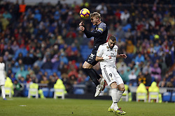 January 19, 2019 - Madrid, Madrid, Spain - Simon Kjaer (Sevilla FC) and  Karim Benzema (Real Madrid) are seen in action during the La Liga football match between Real Madrid and Sevilla FC at the Estadio Santiago Bernabéu in Madrid. (Credit Image: © Manu Reino/SOPA Images via ZUMA Wire)