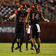 22 September 2018: San Diego State Aztecs safety Tariq Thompson (14) celebrates with safety Parker Baldwin (33) after he made leaping tackle to stop an Eastern Michigan drive in the first quarter. The San Diego State Aztecs beat the Eastern Michigan Eagles 23-20 in over time at SDCCU Stadium in San Diego, California.