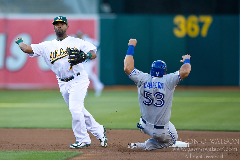 OAKLAND, CA - JULY 05:  Alberto Callaspo #7 of the Oakland Athletics is unable to complete a double play over Melky Cabrera #53 of the Toronto Blue Jays during the first inning at O.co Coliseum on July 5, 2014 in Oakland, California. (Photo by Jason O. Watson/Getty Images) *** Local Caption *** Alberto Callaspo; Melky Cabrera