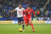 Bolton Wanderers midfielder Liam Trotter  challenges MK Dons midfielder Daniel Powell  during the Sky Bet Championship match between Bolton Wanderers and Milton Keynes Dons at the Macron Stadium, Bolton, England on 23 January 2016. Photo by Simon Davies.