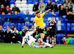 Bristol Rovers' Matty Taylor is fouled by Tranmere Rovers's Steven Jennings - Photo mandatory by-line: Neil Brookman/JMP - Mobile: 07966 386802 - 08/11/2014 - SPORT - Football - Birkenhead - Prenton Park - Tranmere Rovers v Bristol Rovers - FA Cup - Round One