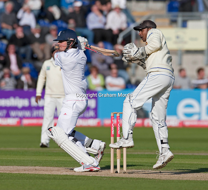 Alastair Cook bats (plus wicket keeper Prasanna Jayawardene) during his century in the first npower Test Match between England and Sri Lanka at the SWALEC Stadium, Cardiff.  Photo: Graham Morris (Tel: +44(0)20 8969 4192 Email: sales@cricketpix.com) 27/05/11