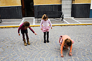 Three girls play in the street on Saturday, March 7, 2009, in Espera, Spain. In Espera, Andalucía, 80 % (approximately) of its inhabitants are currently unemployed due to the financial crisis. The town's economy moved from farming to construction at the beginning of the decade and now almost all the construction companies have closed their doors, as there are no property buyers. The situation is critical and some families have all their members unemployed and with serious problems to bring food to the table. As a result, the local council is giving temporal employment to Espera's residents in order to keep up with the crisis.