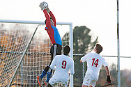 Mt. Anthony goalie Hunter Daivs (1) leaps to make a save during the boys semifinal soccer game between Mount Anthony and Champlain Valley Union at CVU high school on Tuesday afternoon October 27, 2015 in Hinesburg. (BRIAN JENKINS/ for the FREE PRESS)