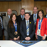 St Johnstone v Hibs...22.03.14    SPFL<br /> Olympic curling bronze medallists Eve Muirhead and Vicki Adams pictured at McDiarmid Park with Chairman Steve Brown and from left, Mike Hay, Charlie Fraser, Roddy Grant, Pete Loudon and David Hay.<br /> Picture by Graeme Hart.<br /> Copyright Perthshire Picture Agency<br /> Tel: 01738 623350  Mobile: 07990 594431