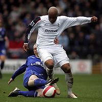 Photo: Paul Thomas.<br /> Bolton Wanderers v Everton. The Barclays Premiership. 09/04/2007.<br /> <br /> El-Hadji Diouf (R) of Bolton is tackled by Tony Hibbert.
