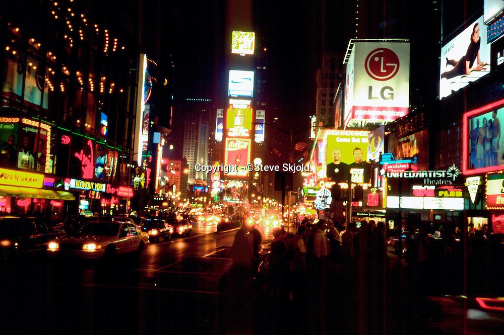 Historic Times Square at night.  New York New York USA